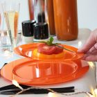 Assiette ronde orange. Recyclable - Réutilisable. Par 12