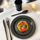 Assiette ronde noire. Recyclable - Réutilisable. Par 12